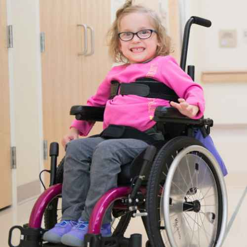 gillette patient in pink wheelchair