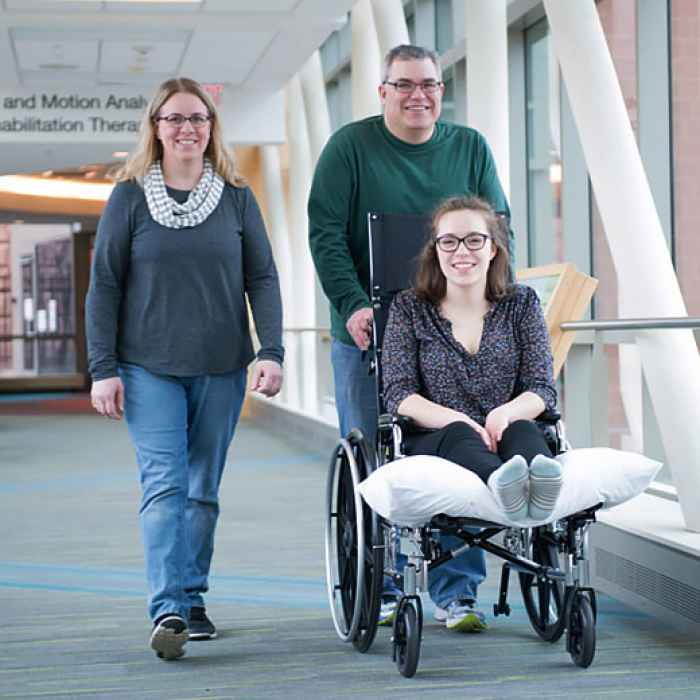 Gillette patient with her family in skyway