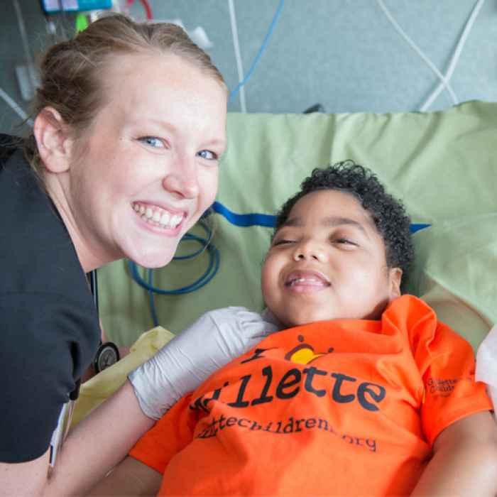 Patient Jeffrey with Gillette nurse during exam