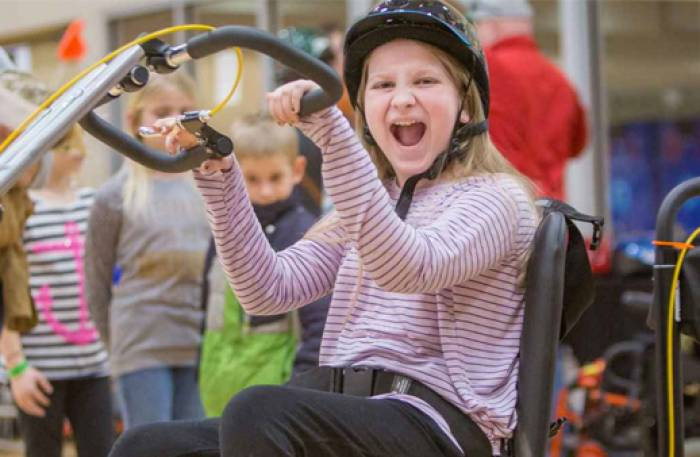 gillette patient using adaptive bike