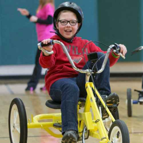 Gillette patient riding an adaptive bike