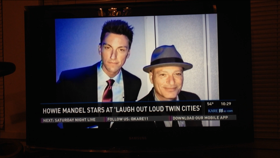 ARE coverage of Jerrid Sebesta, the event's emcee, with Howie Mandel.
