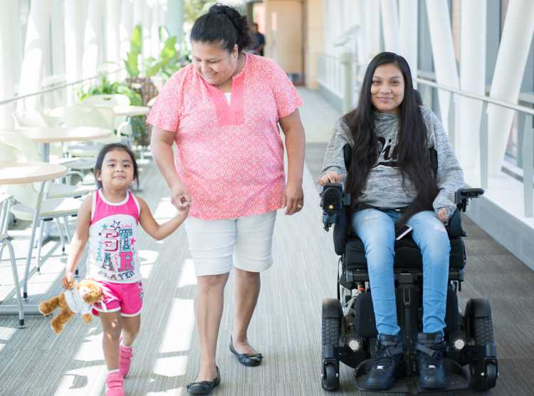 Gillette patient Guadalupe with her family in skyway.