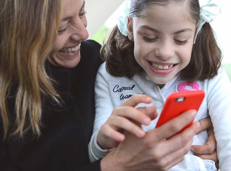 Gillette patient Maria with her mom, appointment reminders by text