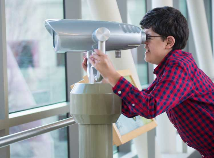Michael Ruud checking out view from skyway binoculars at Gillette children's Specialty Healthcare.