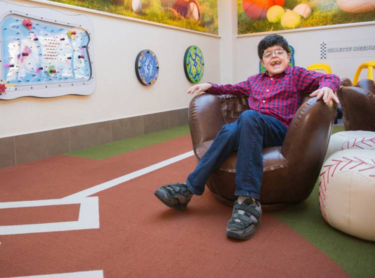Gillette patient Michael in playroom at St. Paul campus.