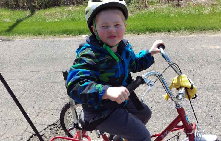 Gavin takes his new adapted bike for a spin