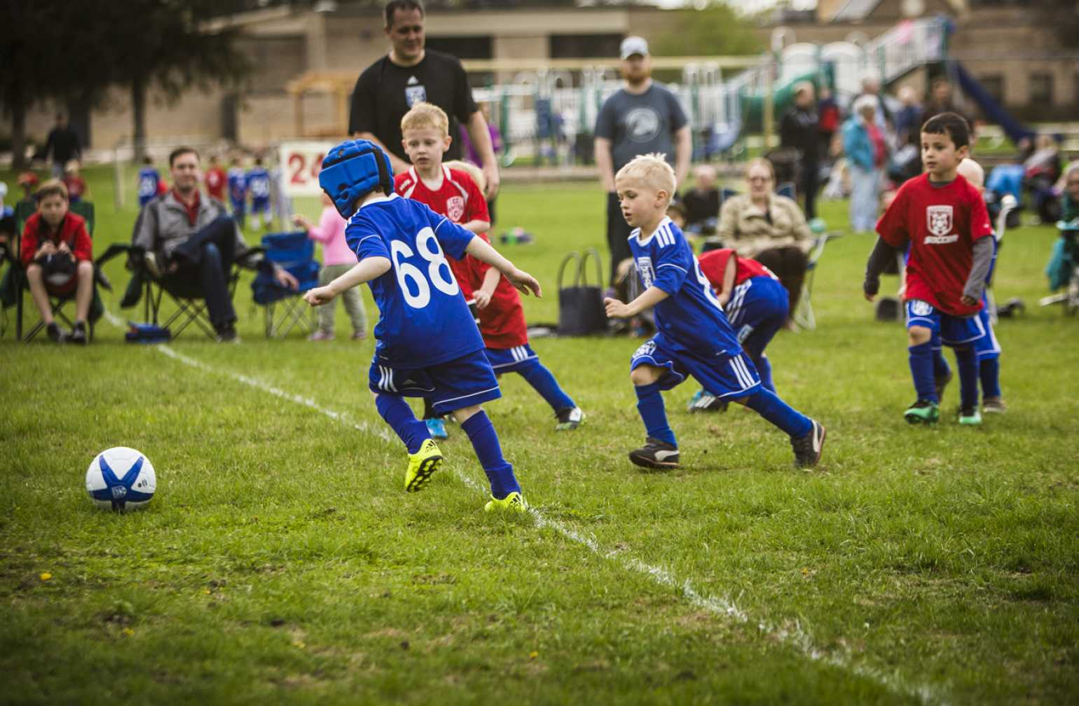 gillette patient Ezra runs to score a goal during soccer game