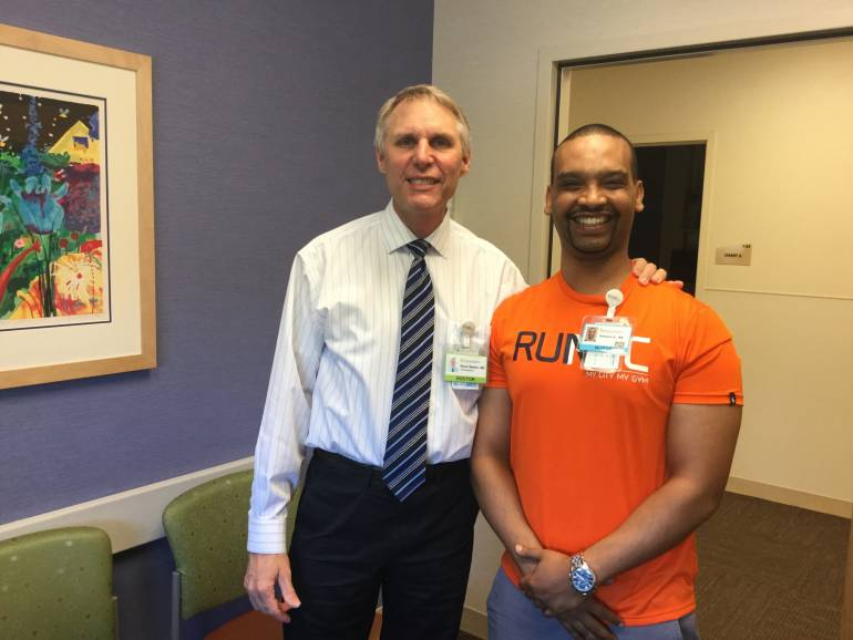 Hakeem Abdulwahab posing with orthopedic surgeon Dr. Kevin Walker