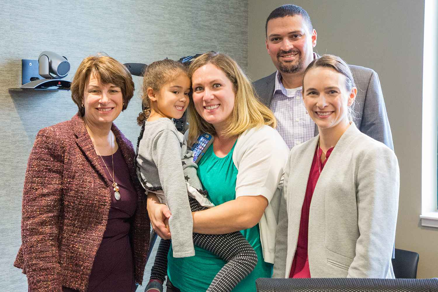 Senator Klobuchar poses with Dr. Angela Sinner and the parents of Sophia Ayouche