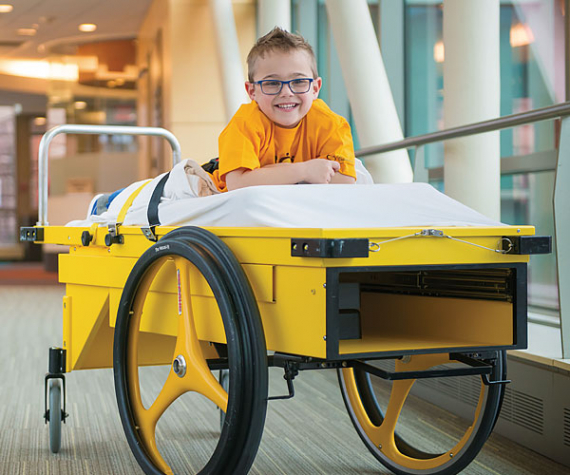 Gillette patient Brock on prone cart who underwent SDR surgery in 2016