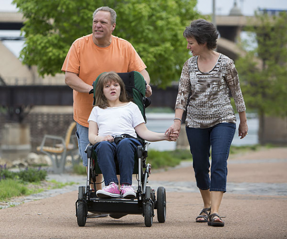 Jill taking a walk with her mom and dad
