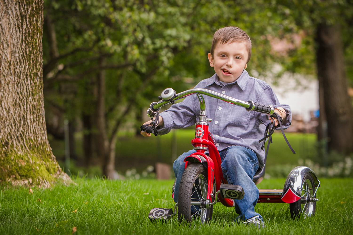 Bentley at home on his shiny red bike.