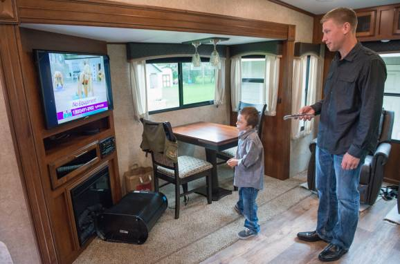 Bentley and his dad inside camper
