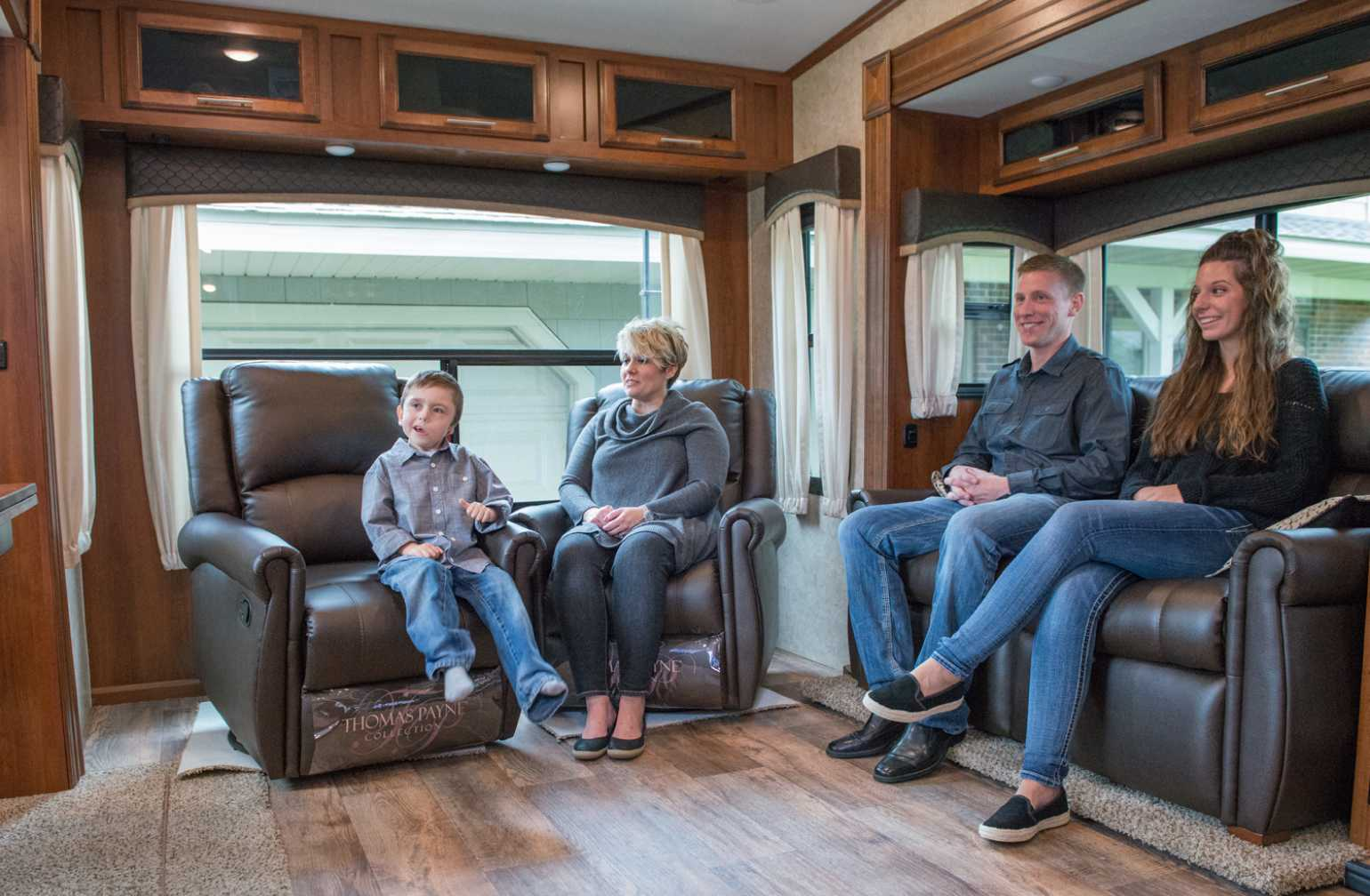 Bentley and family sitting inside camper