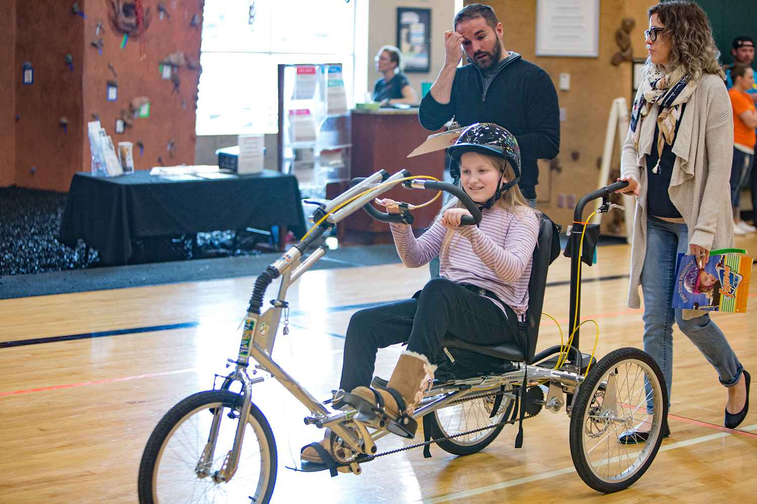 Kiara and her mom consider the adapted bike after a test ride.