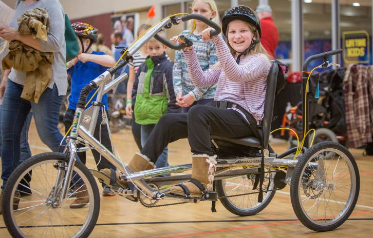 Gillette patient tries out adaptive bike during bike expo