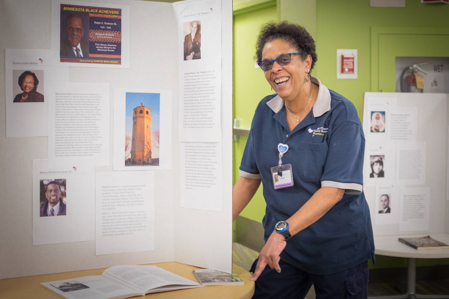 Lynne Washington stands near a Black History Month exhibit.