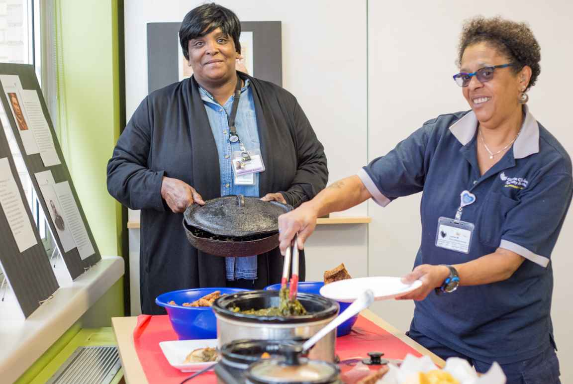 Janet Horton and Lynne Washington enjoy some Black History Month food.