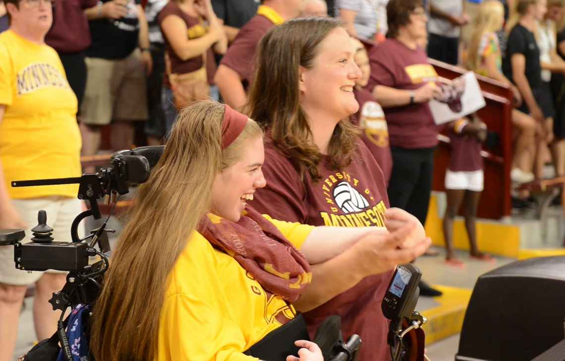 Cassidy getting ready to stand during Gopher volleyball game.