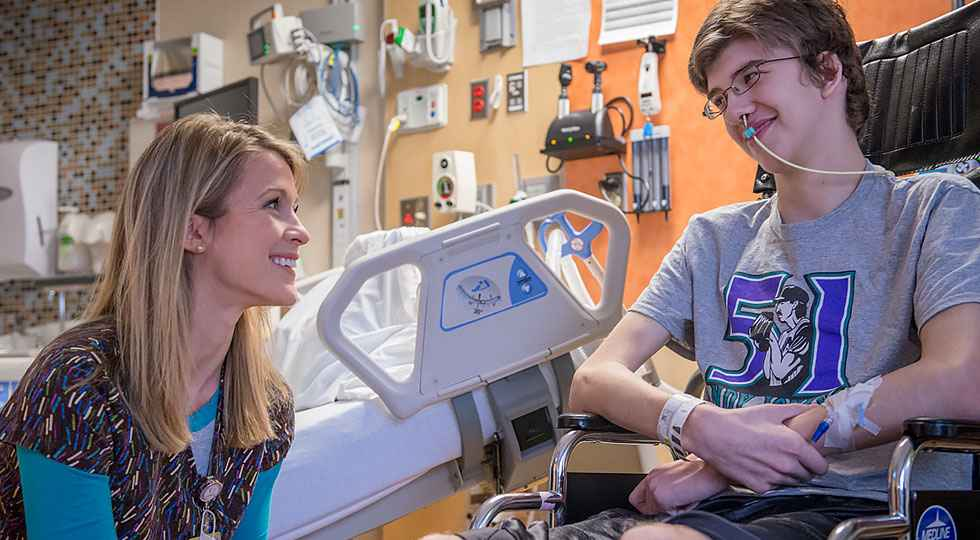 Hunter with nurse at gillette children's