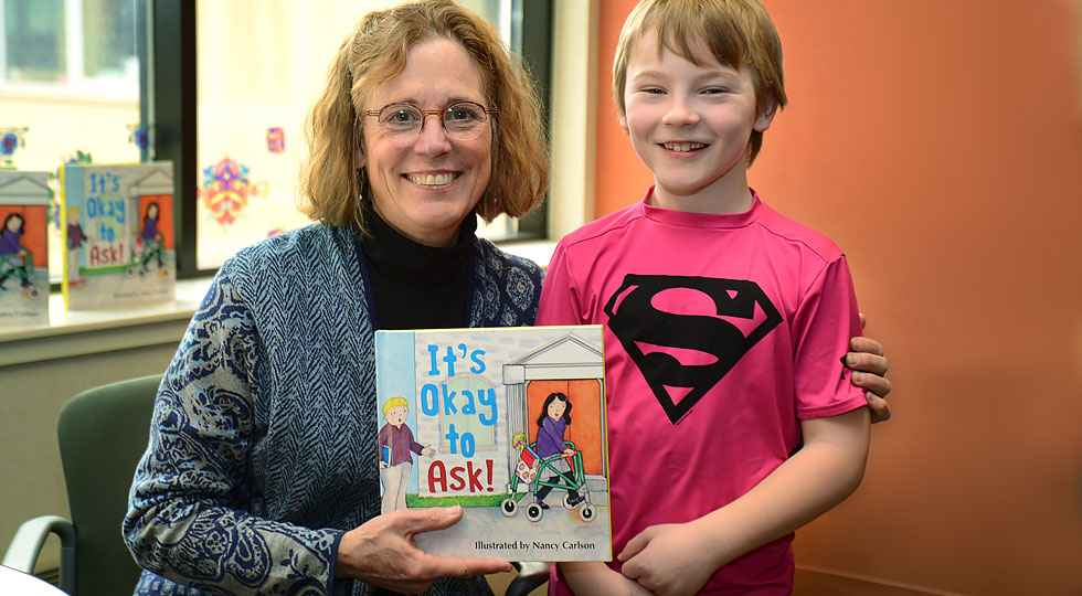 Illustrator nancy carlson with Gillette patient Ty.