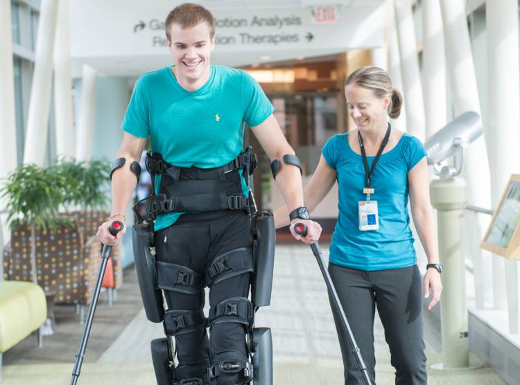 Gillette spinal cord injury patient Jackson working with physical therapist in skyway