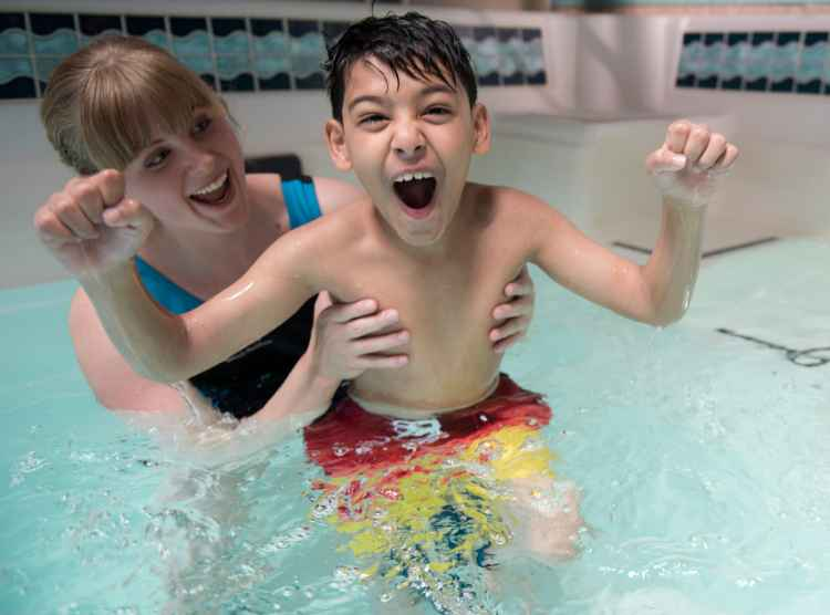 Gillette children's patient, Masood, during aquatic pool therapy