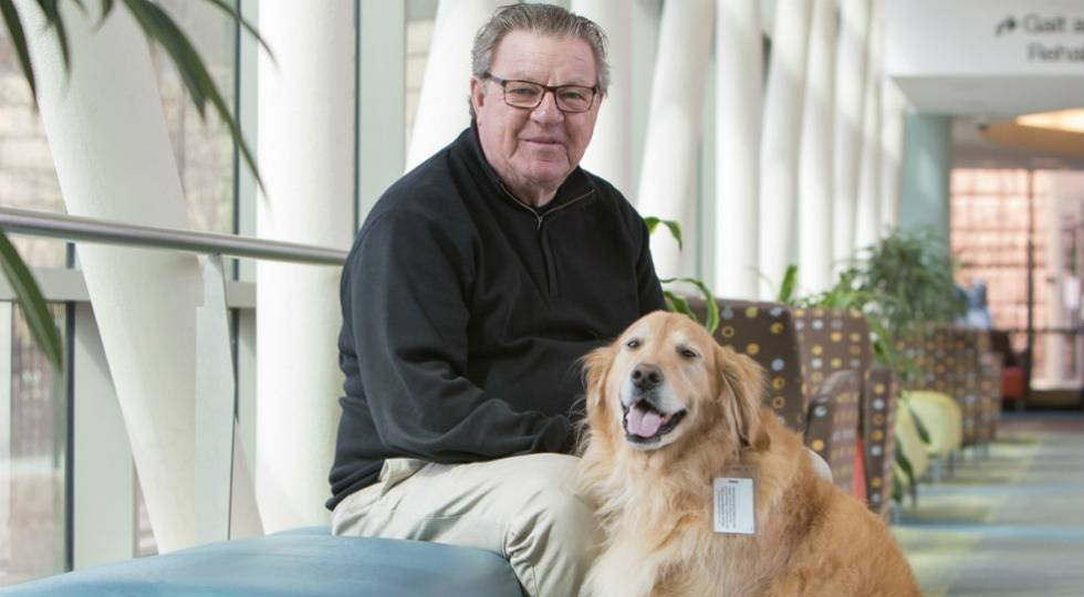 Volunteer with therapy dog at gillette children's specialty healthcare