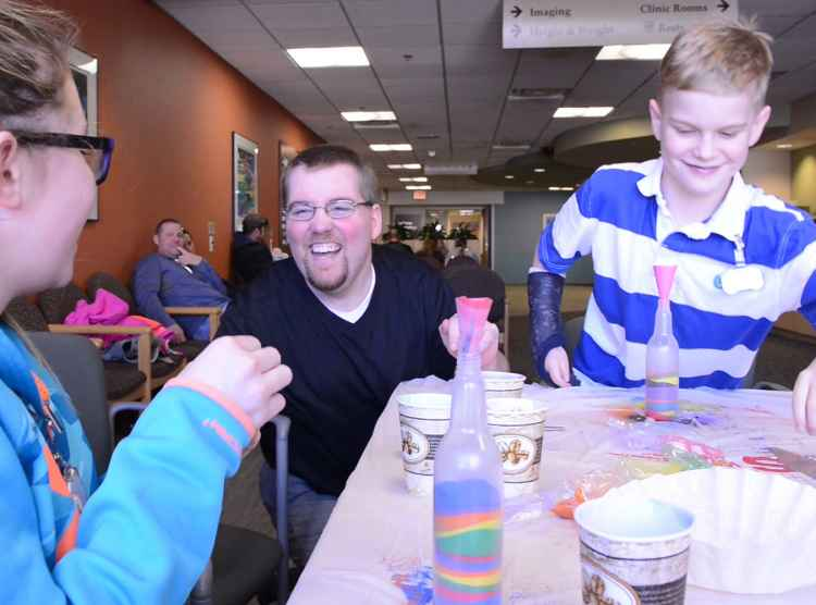 gillette children's adult hospital volunteer interacting with patients