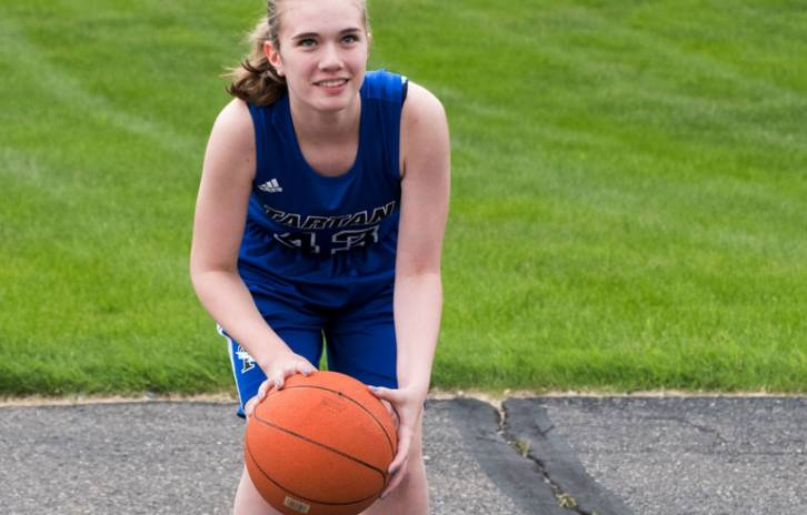 Erika, gillette spine patient, gets ready to shoot hoops