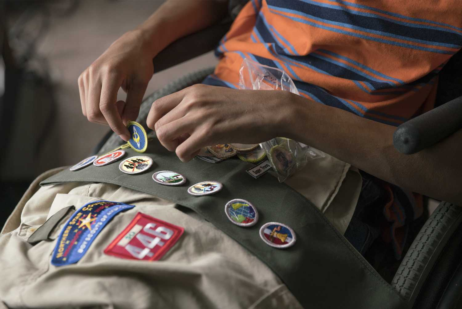 Elijah shows off his Boy Scout badges.