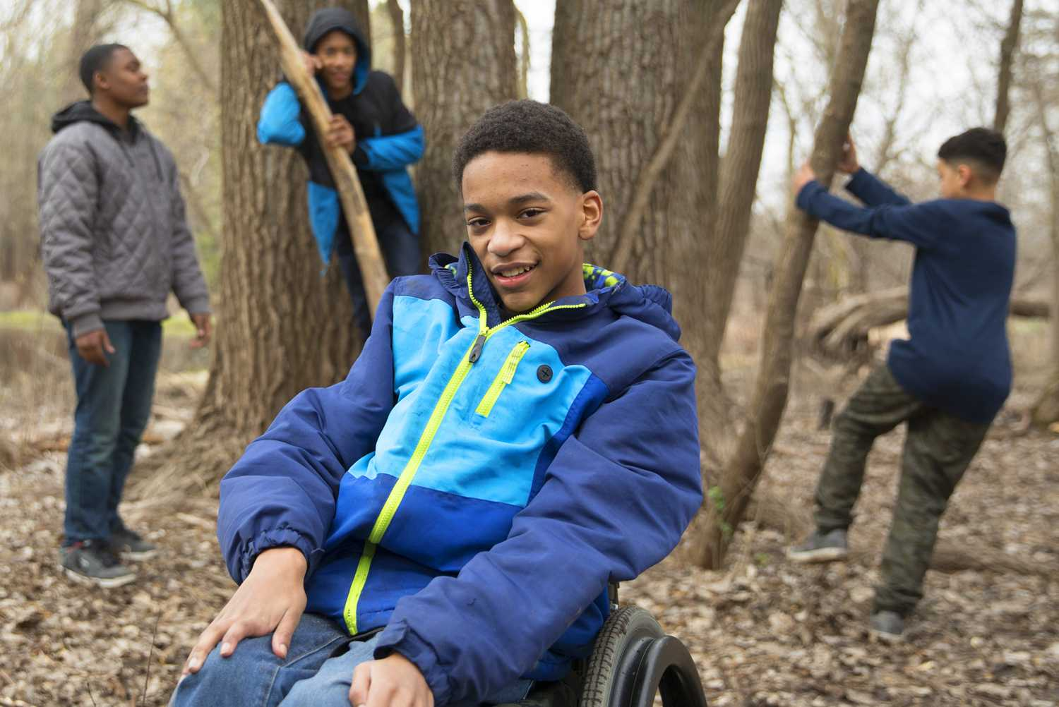 Elijah, who has cerebral palsy, enjoys playing in the woods with his buddies.
