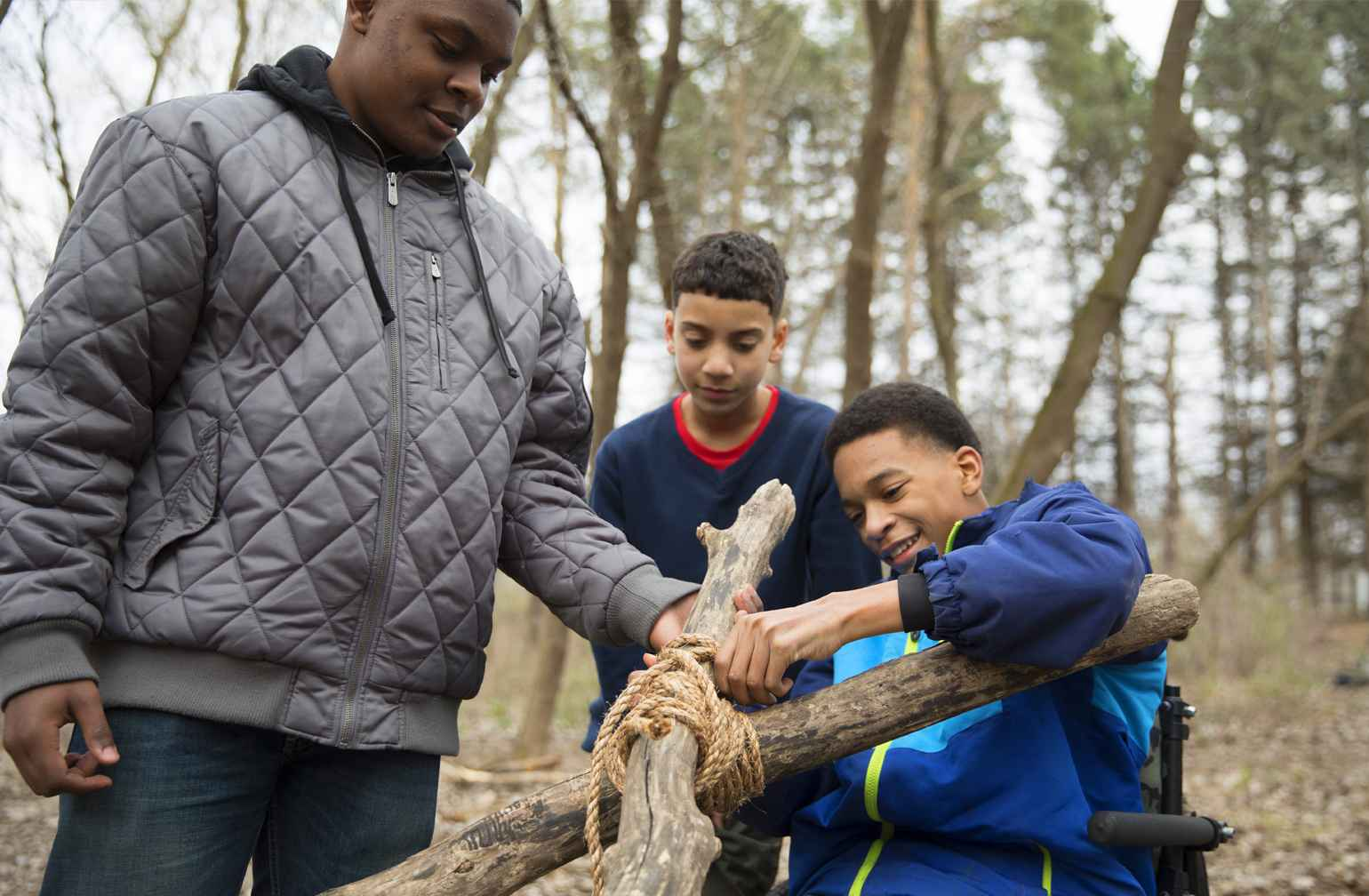 Elijah and his friends push tree branches together