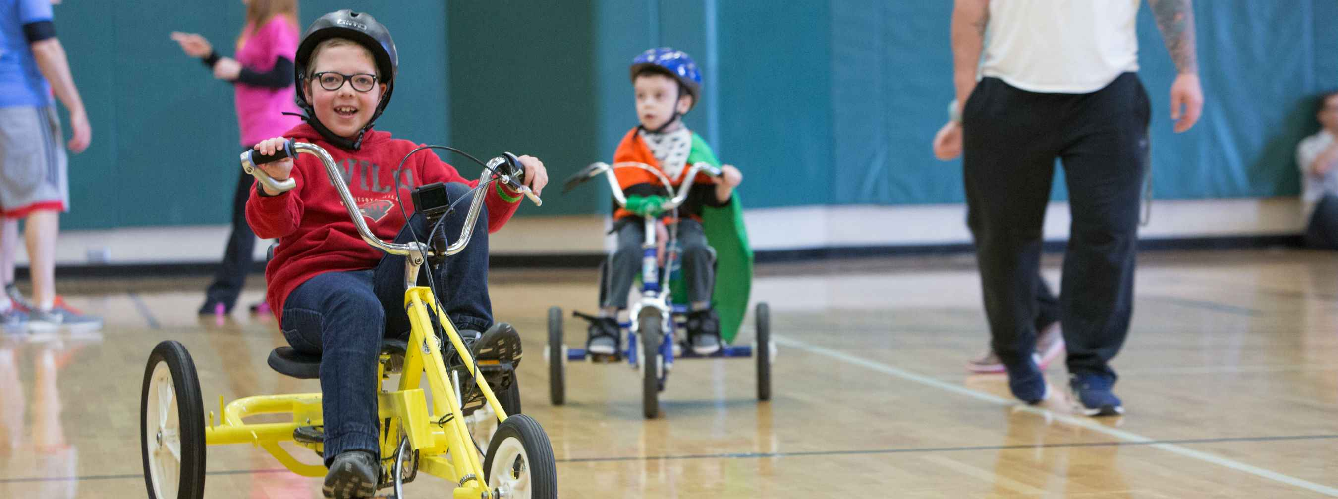 Kids trying out adapted bikes and trikes at the 2017 adapted bike expo