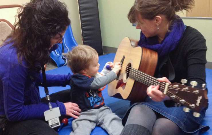 Ezra enjoying music therapy during rehabilitation at gillette children's