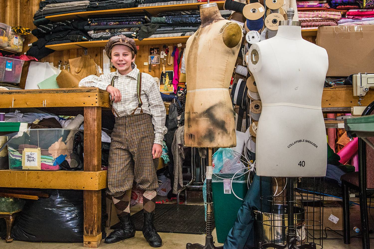 Jon-Erik Chamberlain smiles in the costume shop of the Chanhassen Dinner Theatre.