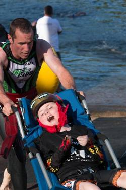 Gillette patient Jeffrey with his dad while running