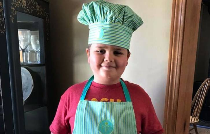 Gillette OI patient, Caleb, in a chef's hat