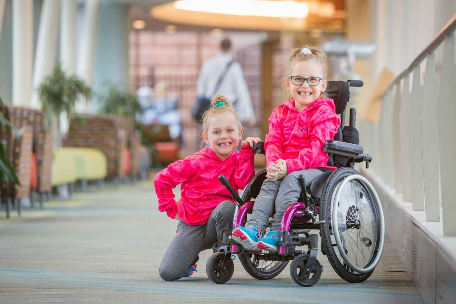 Kaidyn, who receives care for cerebral palsy, and her twin sister Keatyn.