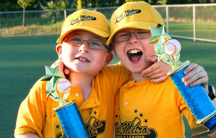 joshua and tyler as younger children holding trophies