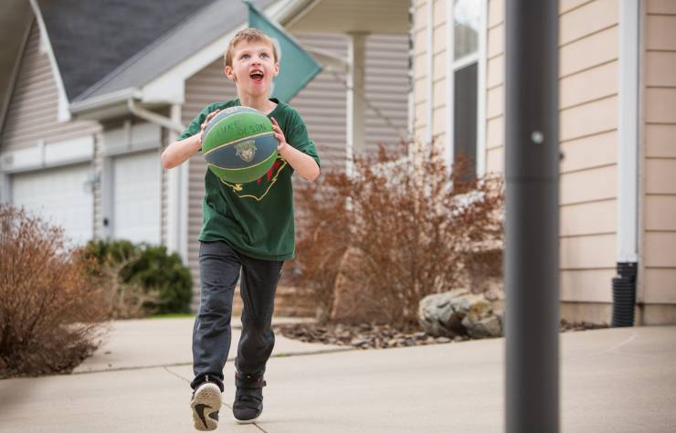 Gillette patient, Luke, plays basketball