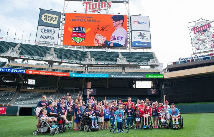 Group photo of Gillette patients at TCF field during Mauer event
