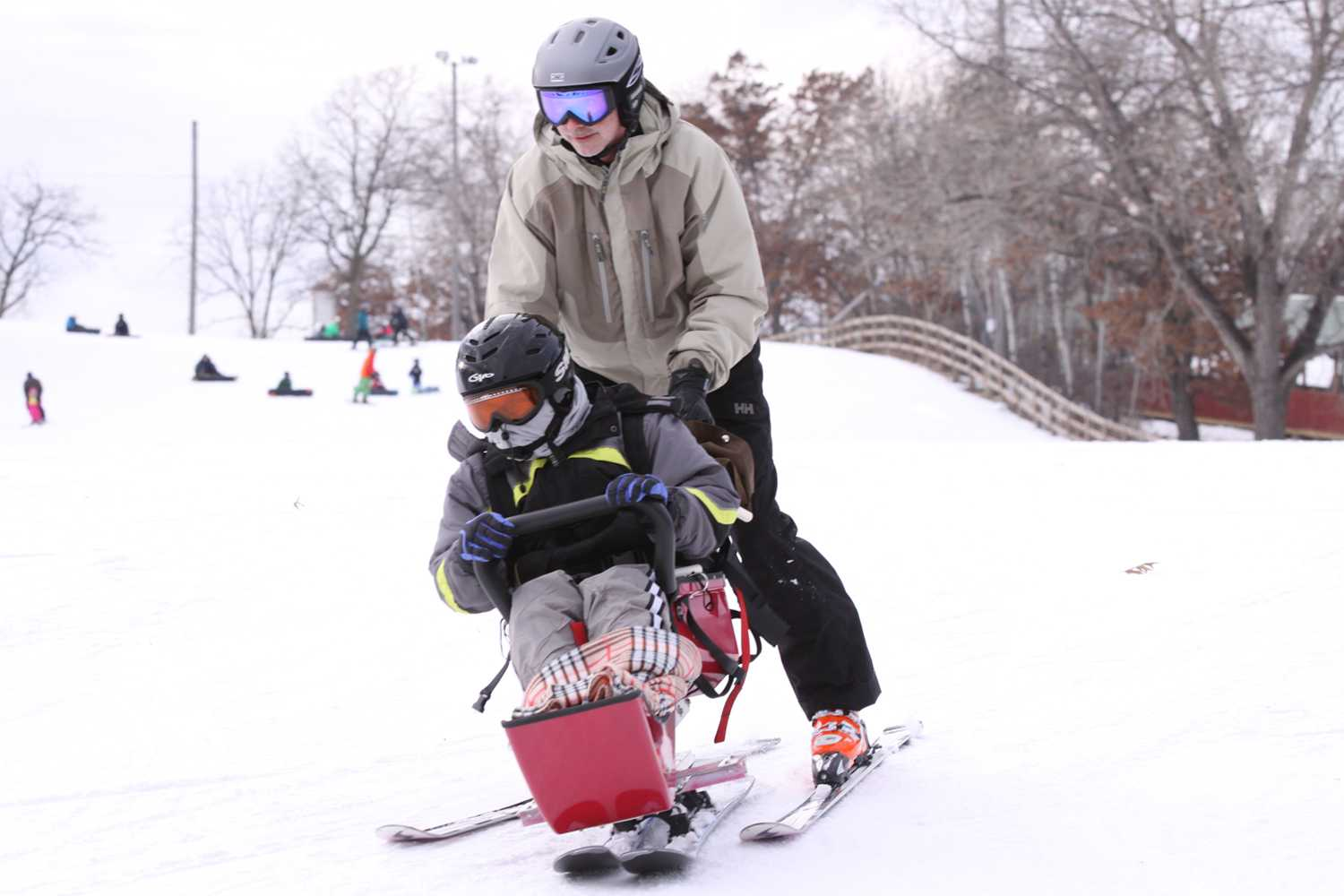 A Gillette patient has fun on adaptive ski day.
