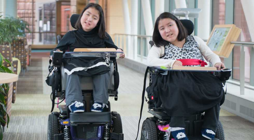 Gillette neuromuscular disorder patients, sisters Kiara and Keisy