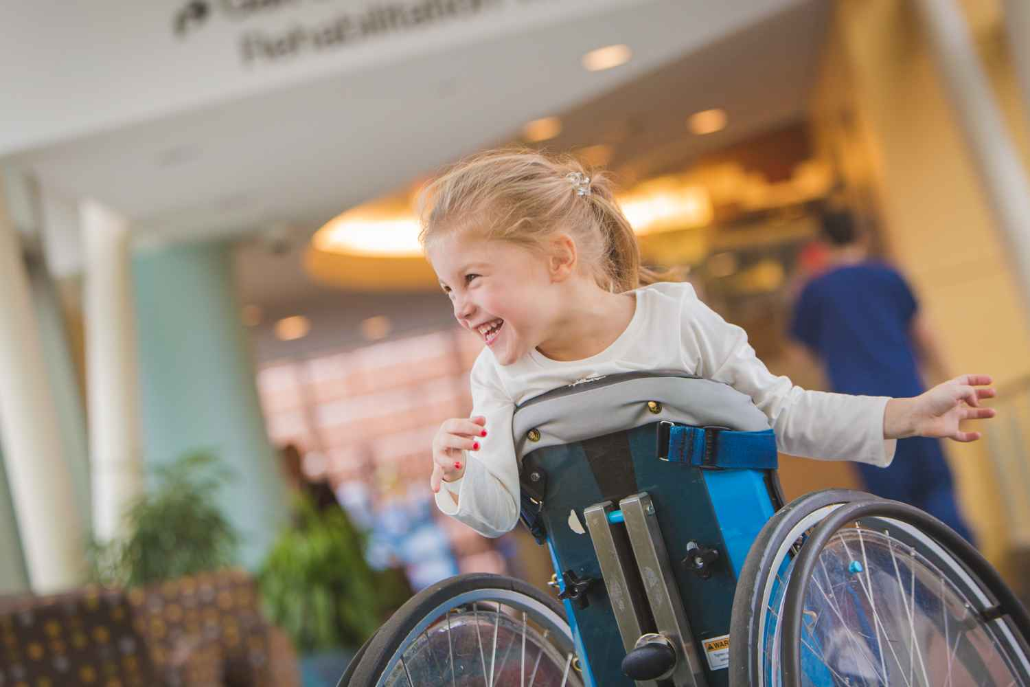 gillette patient Teddy smiles and laughs in skyway