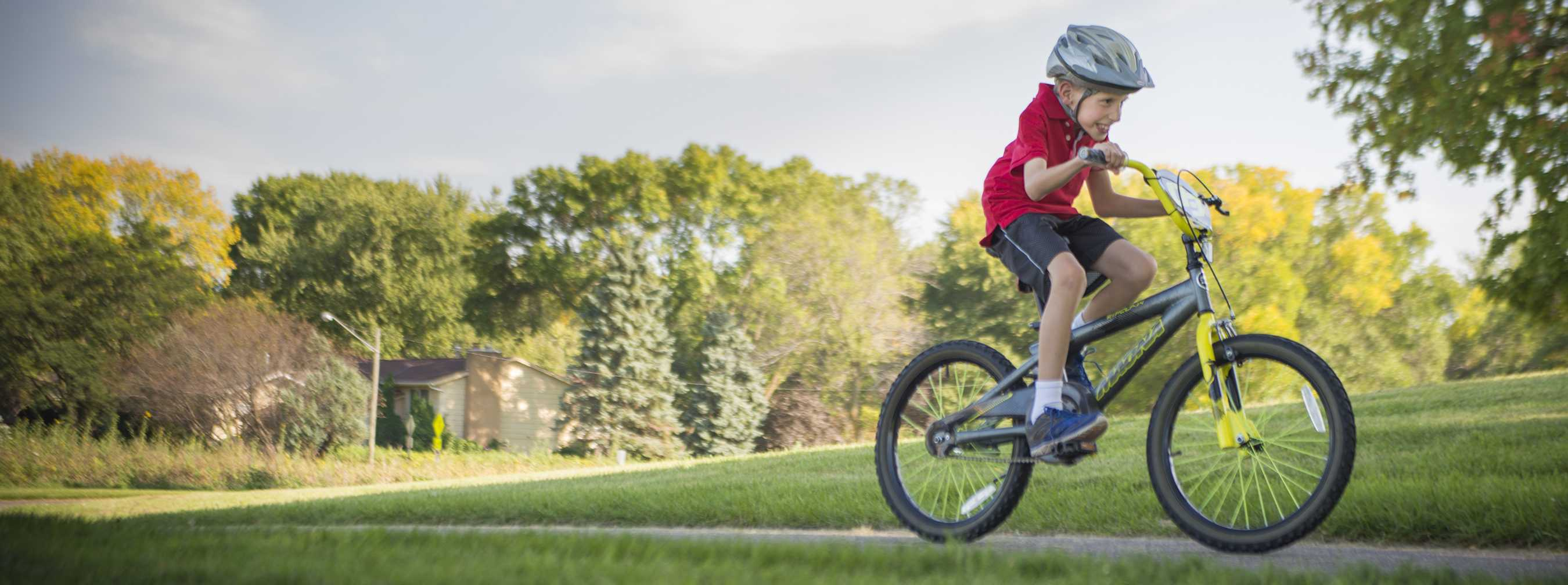 Gillette scoliosis patient Joshua riding a bike