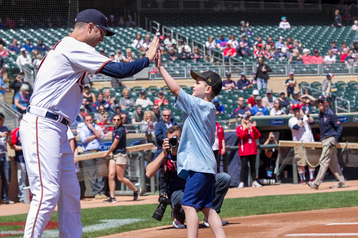 Gillette patient Wyatt gives Joe Mauer a high five