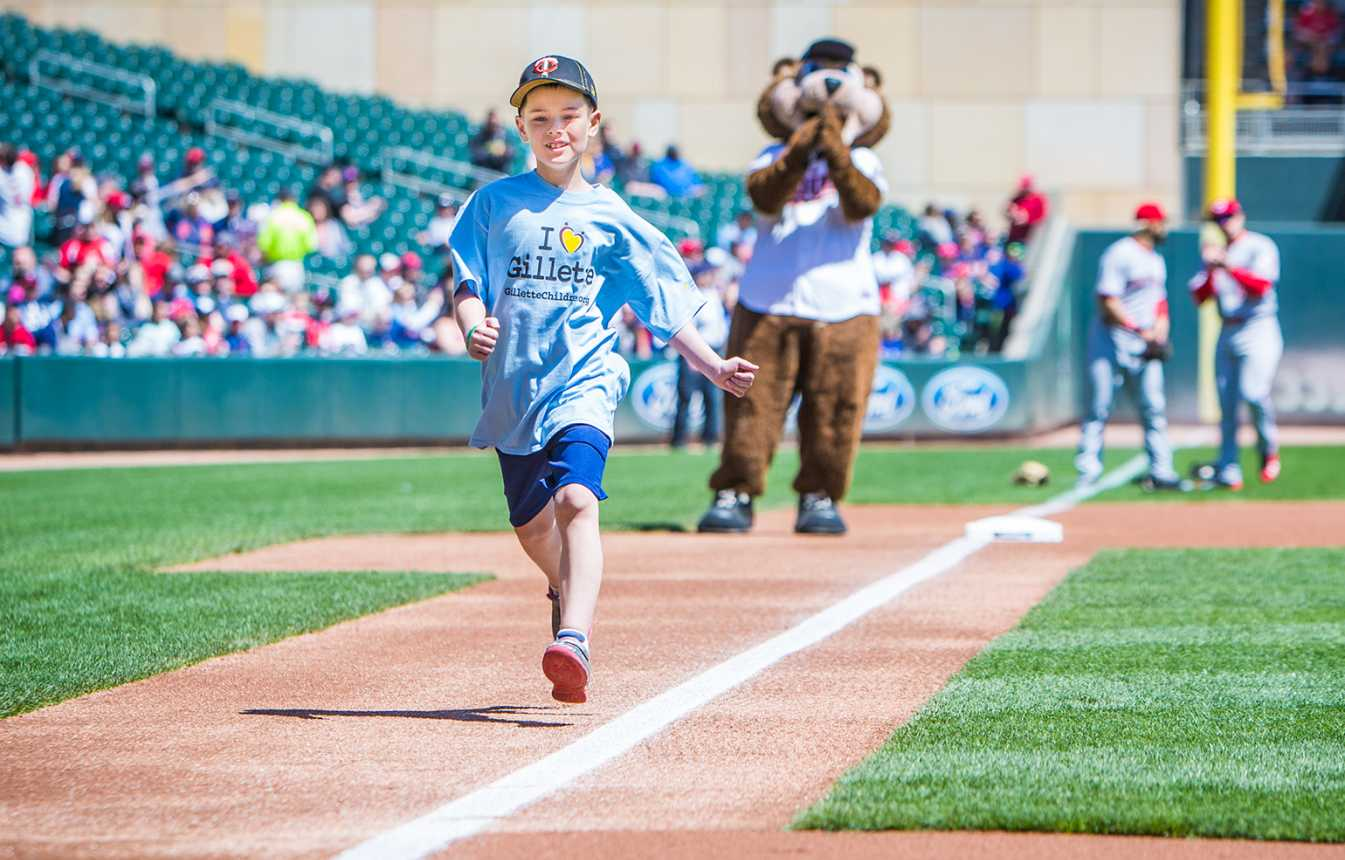 Gillette patient Wyatt runs the bases at Twins game