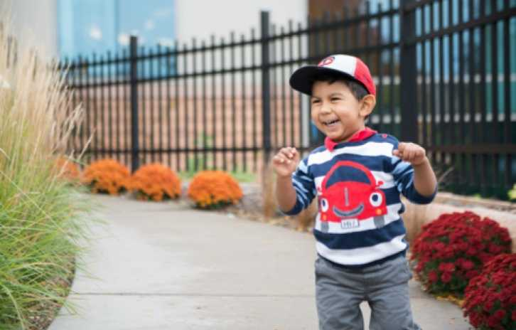Gillette CP and epilepsy patient, Mateo, in healing garden at Gillette children's